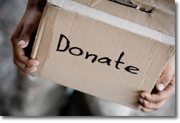 A child holding a donation box.