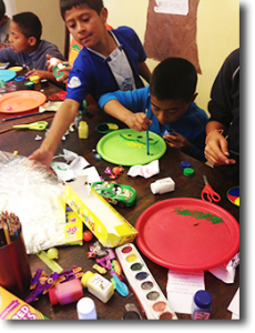 Children in an orphanage making artwork.